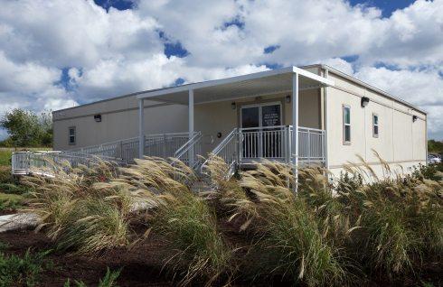 Modular Building in tall grass