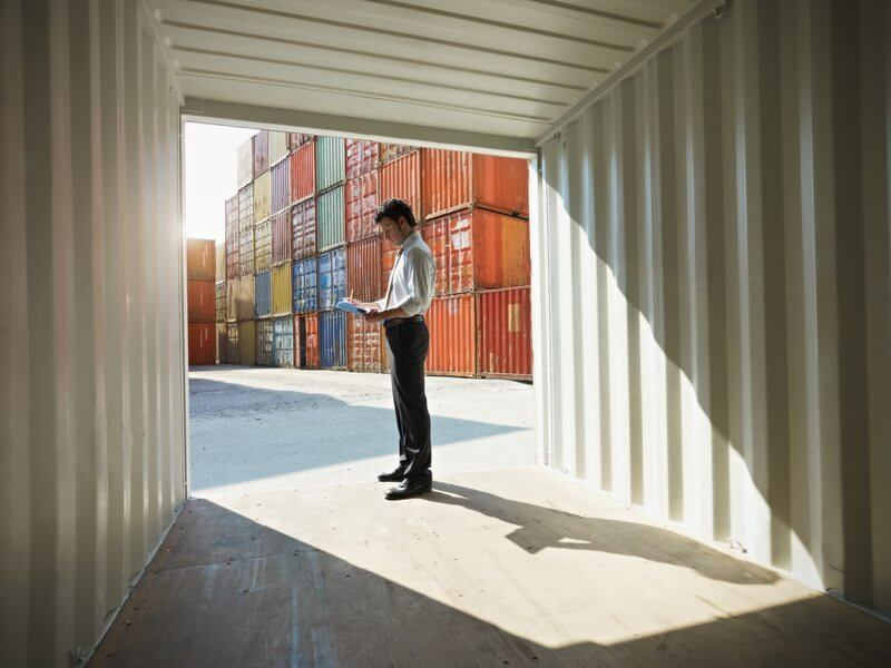 Shipping container being inspected before delivery